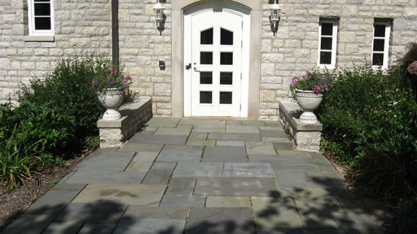 Arched Front Entry and Patterned Flagging - Indiana Limestone